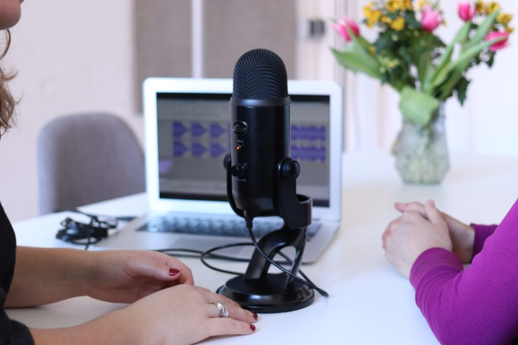 Two women recording podcasts